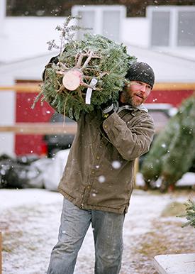 Volunteer with Christmas Tree